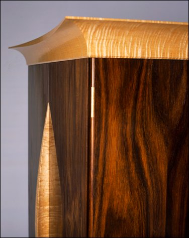 Elegant flowing lines of grain and form created by Greatwood Furniture Company